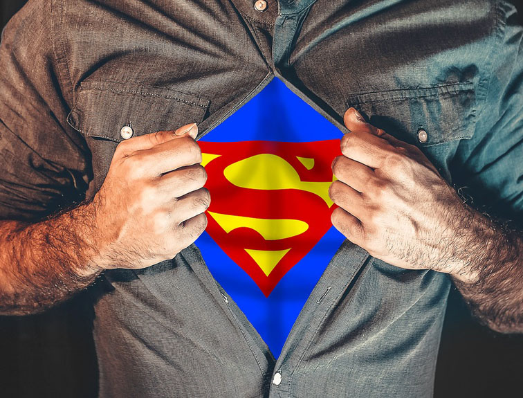Man opening button-up shirt to show superman suit underneath